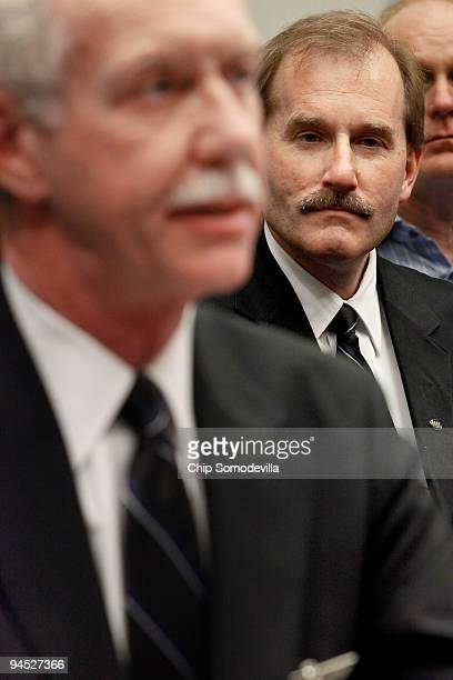 S Airways pilot Jeffrey Skiles listens to Capt Chesley Sully Sullenberger III testify before the House Judiciary Committee's Commercial and...