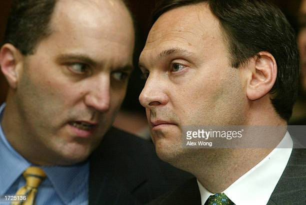 S Airways Senior Vice President for Corporate Affairs Christopher L Chiames talks to President and CEO David Siegel prior to a hearing on US Airways'...