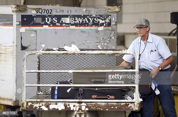 Airways worker unloads baggage into the baggage claim area at Philadelphia International Airport in Philadelphia Pennsylvania Thursday September 14...