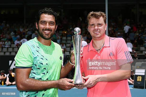 AisamUIHaq Qureshi of Pakistan and Marcin Matkowski of Poland celebrate with the trophy after winning their doubles final match against Jonathan...