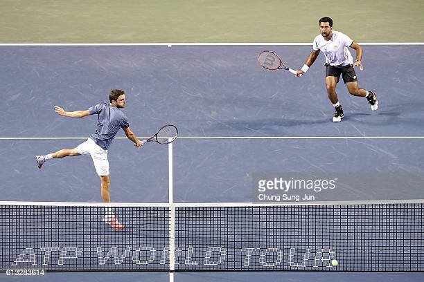 Aisam-Ul-Haq Qureshi of Pakistan and Gilles Simon of France in action during the men's doubles semifinal match against Raven Klaasen of South Africa...