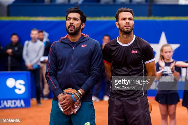 AisamUlHaq Qureshi of Pakistan and JeanJulien Rojer of The Netherlands look on after their defeat against Marc Lopez and Feliciano Lopez of Spain in...