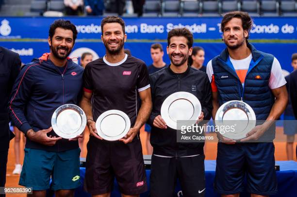 AisamUlHaq Qureshi of Pakistan JeanJulien Rojer of The Netherlands Marc Lopez of Spain and Feliciano Lopez of Spain pose with their trophies after...