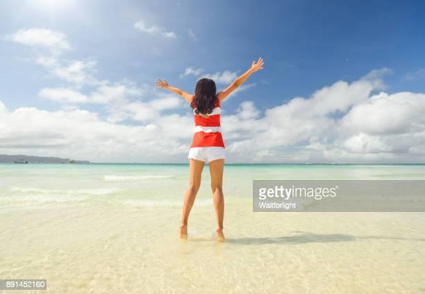 Aisan girl jumping on beach at Boracay