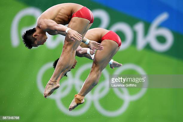 Aisen Chen and Yue Lin of China warm up prior to the Men's Diving Synchronised 10m Platform Final on Day 3 of the Rio 2016 Olympic Games at Maria...
