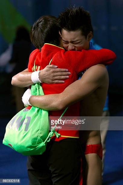 Aisen Chen of China celebrates afer winning gold in the Men's Diving 10m Platform final on Day 15 of the Rio 2016 Olympic Games at the Maria Lenk...