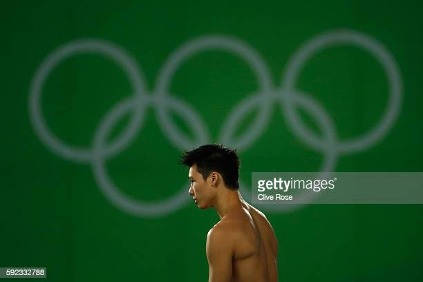 Aisen Chen of China looks on during the Men's Diving 10m Platform final on Day 15 of the Rio 2016 Olympic Games at the Maria Lenk Aquatics Centre on...