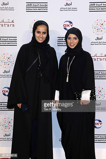 Aisha AlMuhannadi and CEO of Doha Film Institute Fatma Al Remaihi attend the premiere of 'Made in Qatar' during the Ajyal Youth Film Festival on...