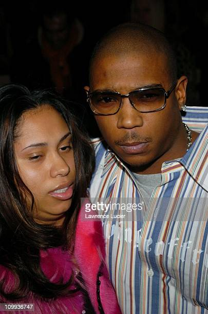 Aisha Atkins and Ja Rule during Olympus Fashion Week Fall 2004 Luca Luca Runway and Front Row at Bryant Park in New York City New York United States