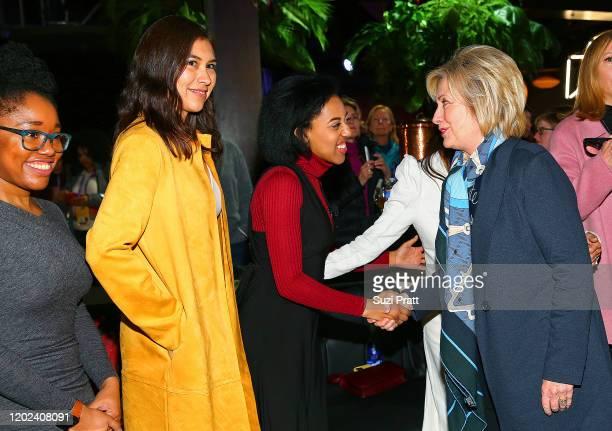 Aisha Harris, Shaandiin Tome and Callie Holley greet Former U.S. Secretary of State and U.S. Senator, Hillary Rodham Clinton during the 2020 Women at...