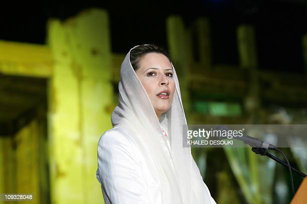 Aisha Kadhafi daughter of Libyan leader Moamer Kadhafi speaks prior to the start of the concert by US soul singer Lionel Ritchie and Spanish tenor...