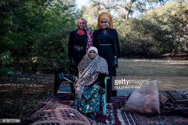 TOPSHOT Aisha Mthimkhulu Ameenah Mthimkhulu stand for a portrait with their mum Fatima Mthimkhulu after the EidGah the prayer on the morning of the...