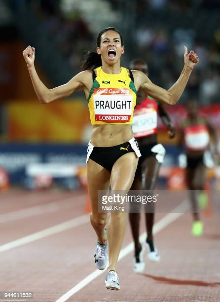 Aisha Praught of Jamaica celebrates as she crosses the line to win gold in the Women's 3000 metres Steeplechase final during athletics on day seven...