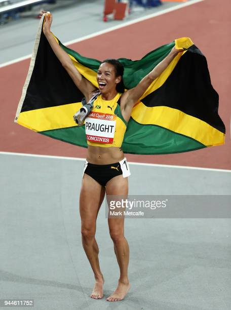 Aisha Praught of Jamaica celebrates as she wins gold in the Women's 3000 metres Steeplechase final during athletics on day seven of the Gold Coast...