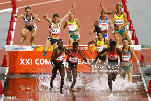 Aisha Praught of Jamaica Celliphine Chepteek Chespol of Kenya and Purity Cherotich Kirui of Kenya clear the water jump in the Women's 3000 metres...
