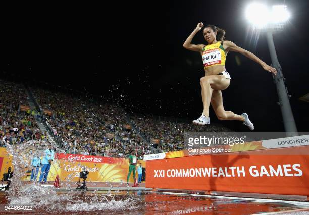 Aisha Praught of Jamaica clears the water jump competes in the Women's 3000 metres Steeplechase final during athletics on day seven of the Gold Coast...