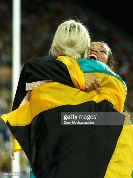Aisha Praught of Jamaica is congratulated by Eloise Wellings of Australia as she wins gold in the Women's 3000 metres Steeplechase final during...