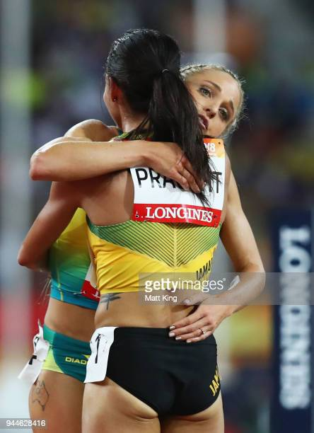 Aisha Praught of Jamaica is congratulated by Genevieve Lacaze of Australia as she wins gold in the Women's 3000 metres Steeplechase final during...