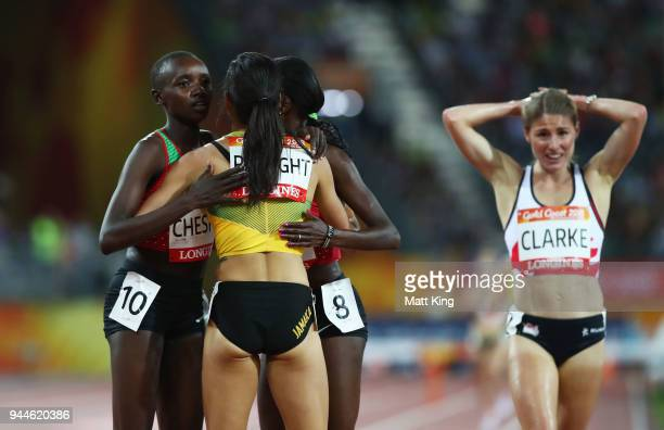 Aisha Praught of Jamaica is congratulated by Purity Cherotich Kirui of Kenya and Celliphine Chepteek Chespol of Kenya as she wins gold as Rosie...