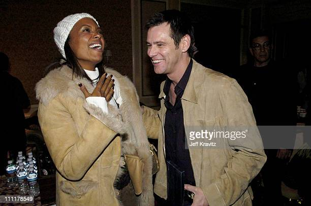 Aisha Tyler and Jim Carrey during US Comedy Arts Festival 2005 Jim Carrey Receives AFI Star Award at St Regis Hotel in Aspen Colorado