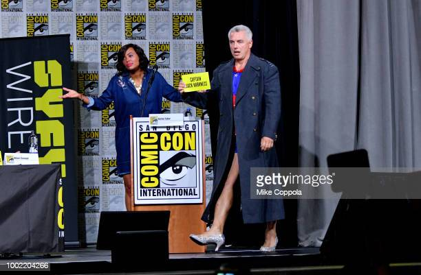 Aisha Tyler and John Barrowman speak onstage at The Great Debate panel hosted by SYFY WIRE during ComicCon International 2018 at San Diego Convention...