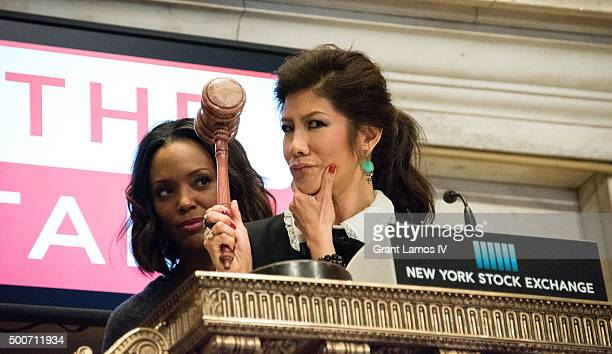 Aisha Tyler and Julie Chen of CBS' 'The Talk' ring the closing bell at the New York Stock Exchange on December 9 2015 in New York City