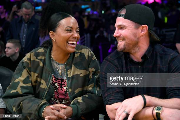 Aisha Tyler and Stephen Amell attend a basketball game between the Los Angeles Lakers and the Milwaukee Bucks at Staples Center on March 01 2019 in...