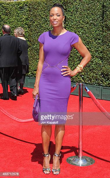 Aisha Tyler arrives at the 2014 Creative Arts Emmy Awards at Nokia Theatre LA Live on August 16 2014 in Los Angeles California