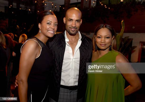 Aisha Tyler Boris Kodjoe and Garcelle Beauvais pose at the after party for the premiere of Columbia Picture's 'Equalizer 2' at the Hollywood...