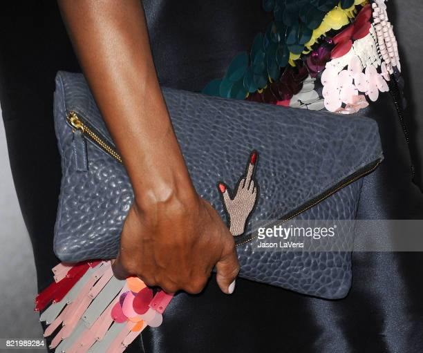 Aisha Tyler handbag detail attends the premiere of Atomic Blonde at The Theatre at Ace Hotel on July 24 2017 in Los Angeles California