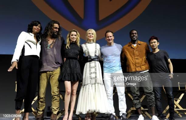 Aisha Tyler Jason Momoa Amber Heard Nicole Kidman Patrick Wilson Yahya AbdulMateen II and James Wan pose onstage at the Warner Bros 'Aquaman'...