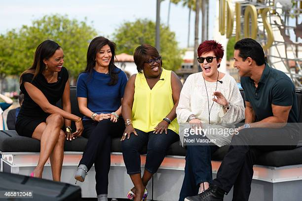 Aisha Tyler Julie Chen Sheryl Underwood Sharon Osbourne and Mario Lopez visit 'Extra' at Universal Studios Hollywood on March 10 2015 in Universal...