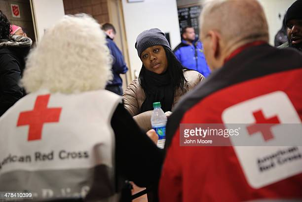 Aisha Watts applies for assistance at an American Red Cross disaster relief center at 125th St and 3rd Avenue a day after an explosion in East Harlem...