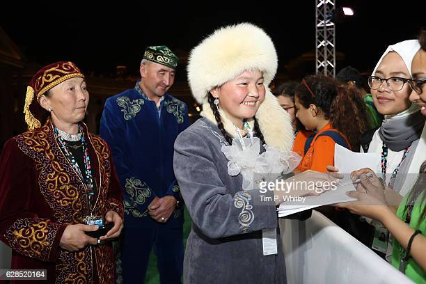 Aisholpan Nurgaiv writes autographs as she attends the closing ceremony and screening of 'The Red Turtle' during the Ajyal Youth Film Festival on...