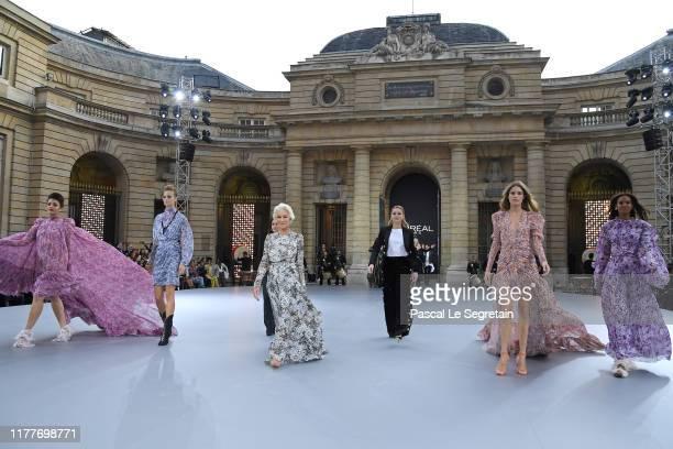 "Aishwarya Rai, a model, Camila Cabello, Helen Mirren, Amber Heard, Doutzen Kroes and Liya Kebede pose on the runway during the ""Le Defile L'Oreal..."