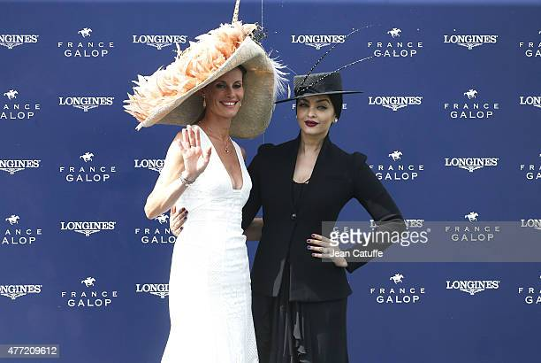Aishwarya Rai and Sophie Thalmann attend the 'Prix de Diane Longines 2015' at Hippodrome de Chantilly on June 14 2015 in Chantilly France