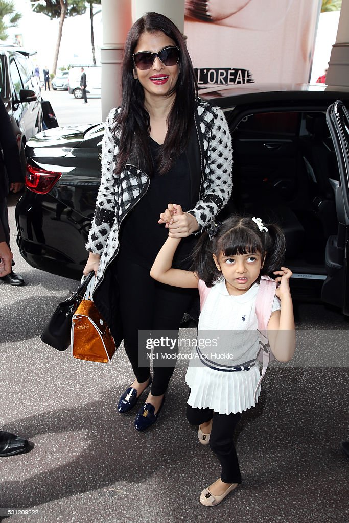 Aishwarya Rai Bachchan and her daughter Aaradhya arrive at the Majestic Hotel during the 69th Annual Cannes Film Festival on May 13 2016 in Cannes...