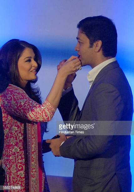 Aishwarya Rai Bachchan feeds cake to her brother Aditya Rai during a function to confer her with French Knight of the Order of Arts and Letters for...