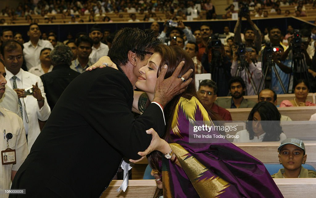 Aishwarya Rai Bachchan greets fatherinlaw Amitabh Bachchan after he received the best actor award for Paa at the 57th National Film Awards ceremony