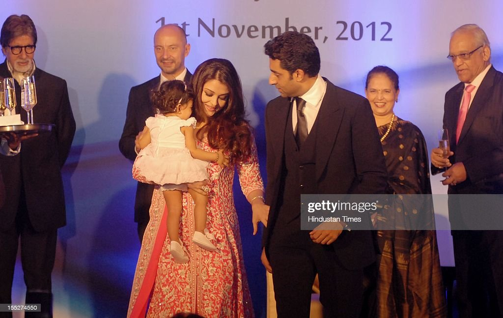 Aishwarya Rai Bachchan on stage with her daughter Aradhya, husband Abhishek Bachchan and father in law Amitabh Bachchan during a function to confer her with French Knight of the Order of Arts and Letters for her contribution to the arts on November 1, 2012 in Mumbai, India. She also celebrated also celebrated her 39th birthday.