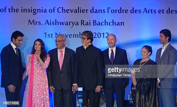 Aishwarya Rai Bachchan on stage with her husband Abhishek Bachchan fatherinlaw Amitabh Bachchan father Krishna Rai mother Brindya Rai brother Aditya...