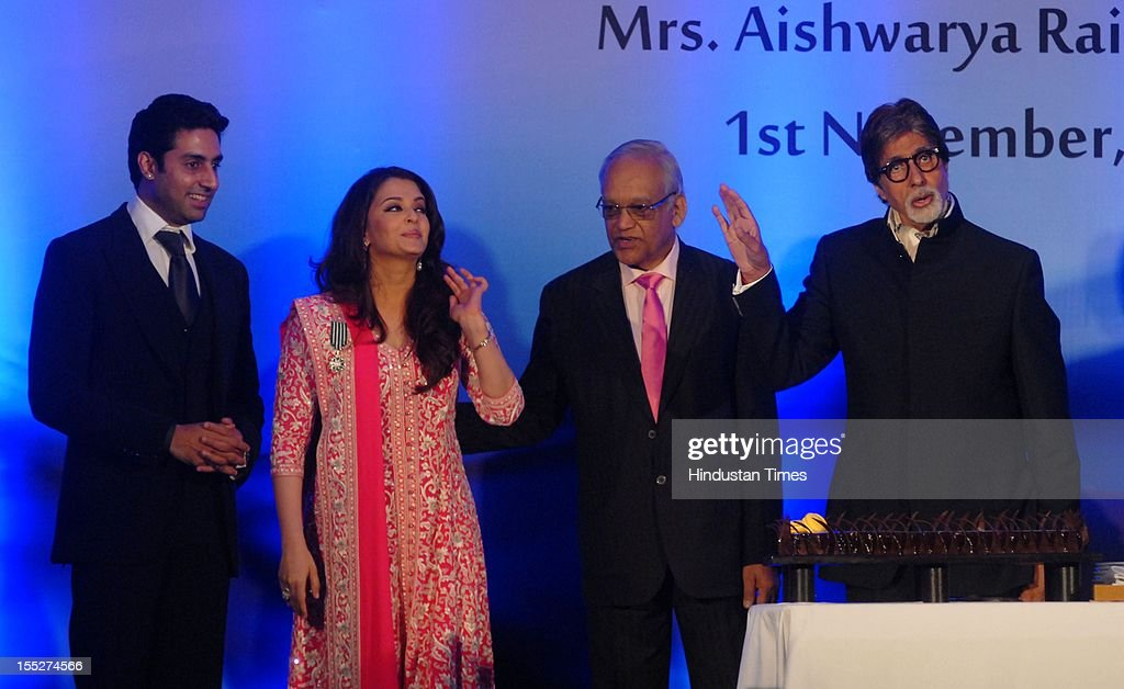 Aishwarya Rai Bachchan on stage with her husband Abhishek Bachchan father in law Amitabh Bachchan father Krishna Rai during a function to confer her..