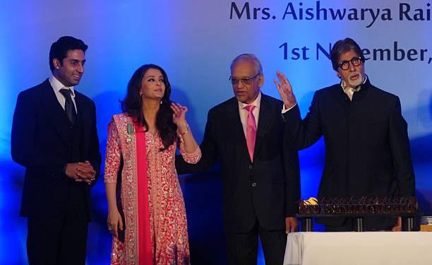 Aishwarya Rai Bachchan on stage with her husband Abhishek Bachchan father in law Amitabh Bachchan father Krishna Rai during a function to confer her..