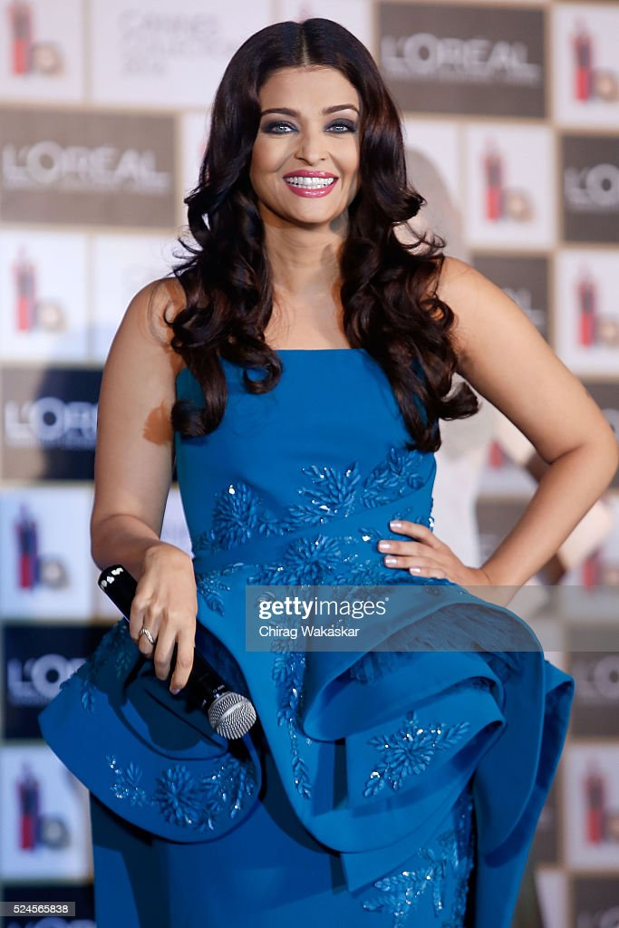Aishwarya Rai Bachchan poses for pictures at the press conference to celebrate 15 years at Cannes as she launches L`oreal Paris`s Infallible...