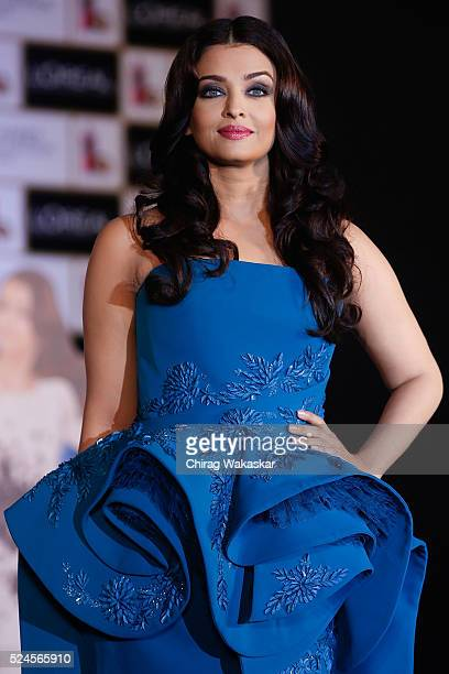 Aishwarya Rai Bachchan poses for pictures at the press conference to celebrate 15 years at Cannes as she launches L'oreal Paris's Infallible...