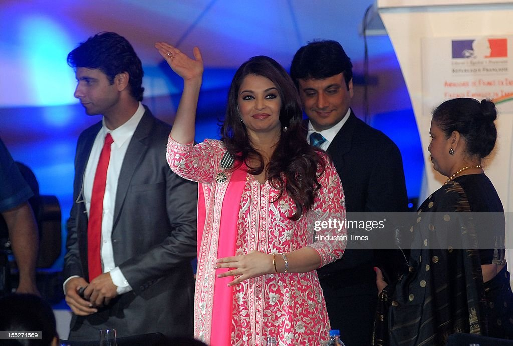 Aishwarya Rai Bachchan waves during a function to confer her with French Knight of the Order of Arts and Letters for her contribution to the arts on November 1, 2012 in Mumbai, India. She also celebrated also celebrated her 39th birthday.