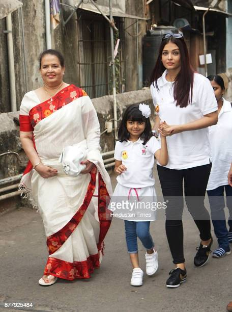 Aishwarya Rai Bachchan with her daughter Aaradhya and mother and NGO Smile Train during unveils Day of Smiles in the memory of her father Krishnaraj...