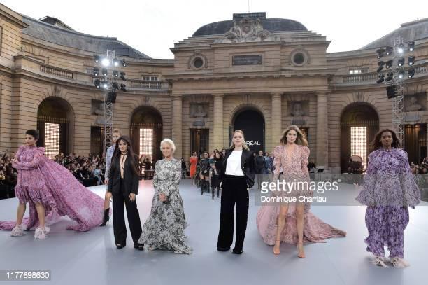 "Aishwarya Rai, Camila Cabello, Helen Mirren, Amber Heard, Doutzen Kroes and Liya Kebede pose on the runway during the ""Le Defile L'Oreal Paris"" Show..."
