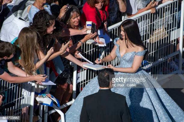 Aishwarya Rai greets fans as she attends the 'Okja' premiere during the 70th annual Cannes Film Festival at Palais des Festivals on May 19 2017 in...