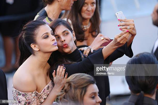 Aishwarya Rai is taking a selfie with a fan at the 'From The Land Of The Moon ' premiere during the 69th annual Cannes Film Festival at the Palais...